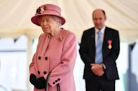 SALISBURY, ENGLAND - OCTOBER 15: Britain's Queen Elizabeth II speaks with staff including Professor Tim Atkins (R), who was honoured for his work on the 2018 Novichok incident and has been involved in the fight against Covid-19, during a visit to the Defence Science and Technology Laboratory (Dstl) at Porton Down science park on October 15, 2020 near Salisbury, England. The Queen and the Duke of Cambridge visited the Defence Science and Technology Laboratory (Dstl) where they were to view displays of weaponry and tactics used in counter intelligence, a demonstration of a Forensic Explosives Investigation and meet staff who were involved in the Salisbury Novichok incident. Her Majesty and His Royal Highness also formally opened the new Energetics Analysis Centre. (Photo by Ben Stansall - WPA Pool/Getty Images)