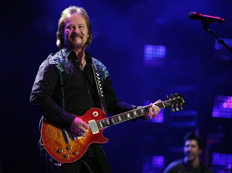 """In this Friday, June 6, 2014 file photo, Travis Tritt performs during the CMA Fest at LP Field in Nashville, Tenn. Country music star Tritt says his tour bus was """"sideswiped"""" in a multi-vehicle crash that left several people dead in South Carolina. News outlets report the crash occurred early Saturday, May 18, 2019, on Highway 22 in Horry County. (Photo by Wade Payne/Invision/AP, File)"""