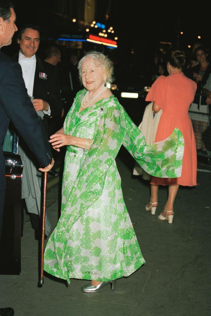 <p>The Queen Mother arrived at an event at the London Coliseum in a vibrant green floral chiffon evening gown. She added some glamour with a multi-strand pearl necklace and emerald drop earrings. </p>