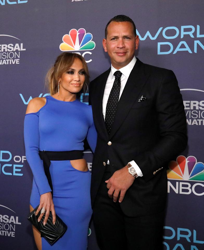"Judge Jennifer Lopez and former baseball player Alex Rodriguez pose at an event for the television series ""World of Dance"" in West Hollywood, California, U.S., September 19, 2017. REUTERS/Mario Anzuoni"