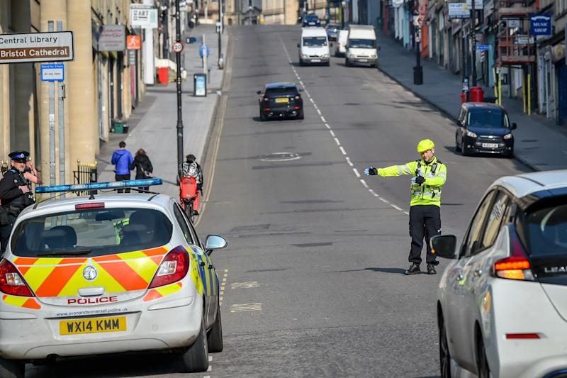 Police stop motorists as they travel on Park Street, Bristol, where random checks on essential travel are taking place as the UK continues in lockdown to help curb the spread of the coronavirus. (Photo by Ben Birchall/PA Images via Getty Images)