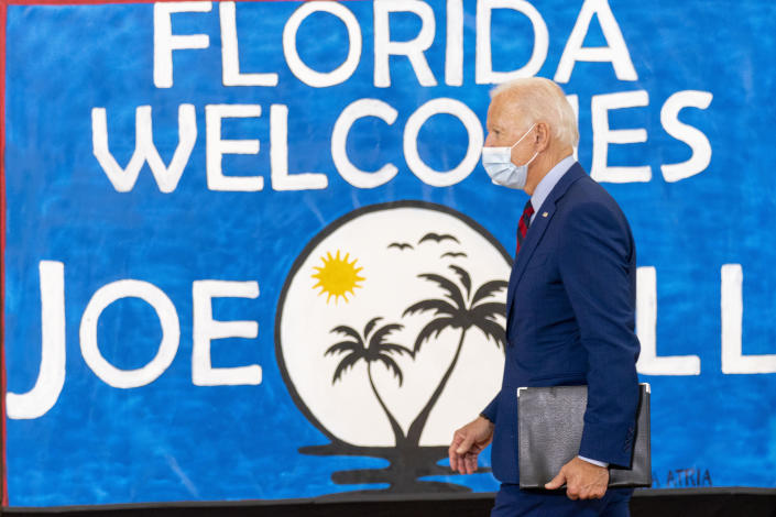 Democratic presidential candidate former Vice President Joe Biden leaves after speaking at Jose Marti Gym, Monday, Oct. 5, 2020, in Miami. (AP Photo/Andrew Harnik)