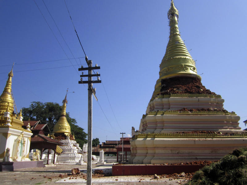 Pagodas in Kyaukmyaung, east of Shwebo, Myanmar are seen destroyed after a strong earthquake on Sunday, Nov. 11, 2012. The magnitude-6.8 quake struck northern Myanmar on Sunday, collapsing a bridge and a gold mine, damaging several old Buddhist pagodas and leaving as many as 12 people feared dead. (AP Photo/Weekly Eleven News) MANDATORY CREDIT