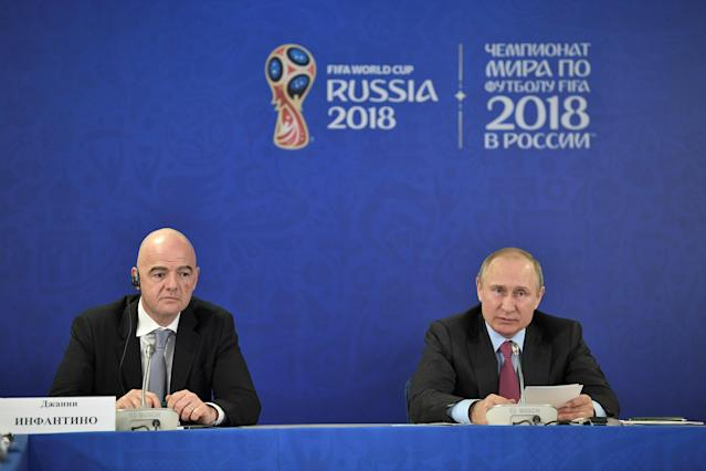Russian President Vladimir Putin (R) and FIFA President Gianni Infantino attend a meeting with members of the Supervisory Board of the 2018 FIFA World Cup Organising Committee in Sochi, Russia May 3, 2018. Sputnik/Aleksey Nikolskyi/Kremlin via REUTERS ATTENTION EDITORS - THIS IMAGE WAS PROVIDED BY A THIRD PARTY.