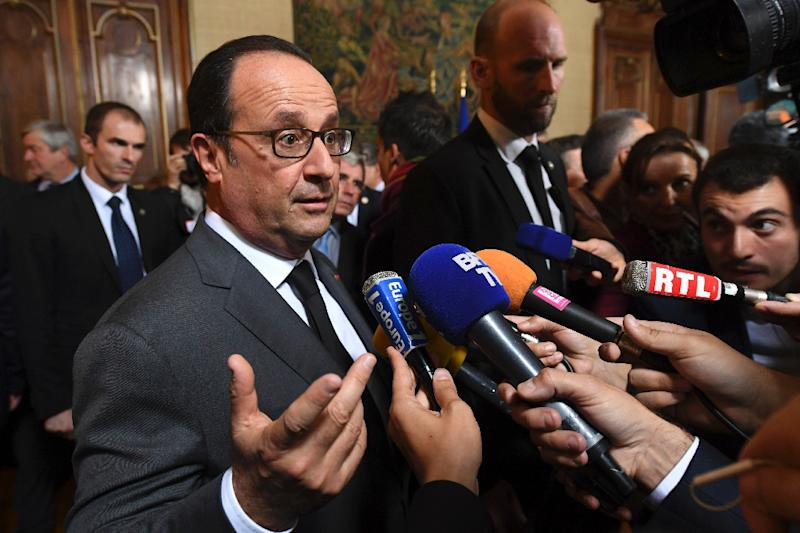 French President Francois Hollande talks to the press on October 8, 2016 in Tulle as part of his visit in Correze