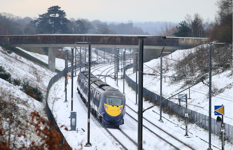A train passes through Ashford in Kent following overnight rain and snow. (Photo by Gareth Fuller/PA Images via Getty Images)