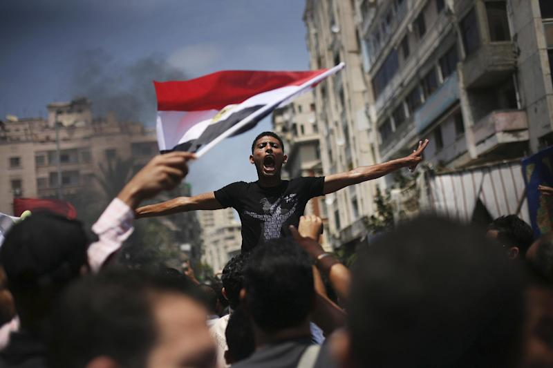 An Egyptian protester chants slogans against presidential candidate Ahmed Safiq during a demonstration against the Supreme Constitutional Court rulings in Alexandria, Egypt, June 15, 2012. Judges appointed by Hosni Mubarak dissolved the Islamist-dominated parliament Thursday and ruled his former prime minister eligible for the presidential runoff election this weekend, setting the stage for the military and remnants of the old regime to stay in power. (AP Photo/Manu Brabo)