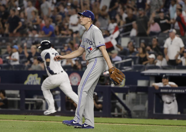 Toronto Blue Jays starting pitcher Aaron Sanchez reacts as he watches a ball hit by New York Yankees' Edwin Encarnacion (30) for a three-run double during the fifth inning of a baseball game Friday, July 12, 2019, in New York. (AP Photo/Frank Franklin II)
