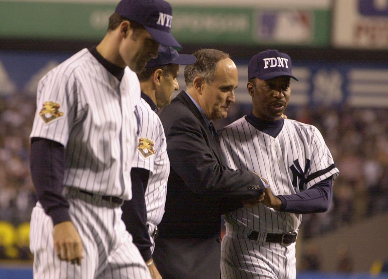 New York City Mayor Rudolph Giuliani shakes hands with Willie Randolph of the New York Yankees before the Yankees game against the Tampa Bay Devil Rays at Yankee Stadium September 25, 2001 in the Bronx, New York. This is the first baseball game played at Yankee stadium since the terrorist attack on the twin towers. (Photo by Ezra Shaw/Allsport/Getty Images)