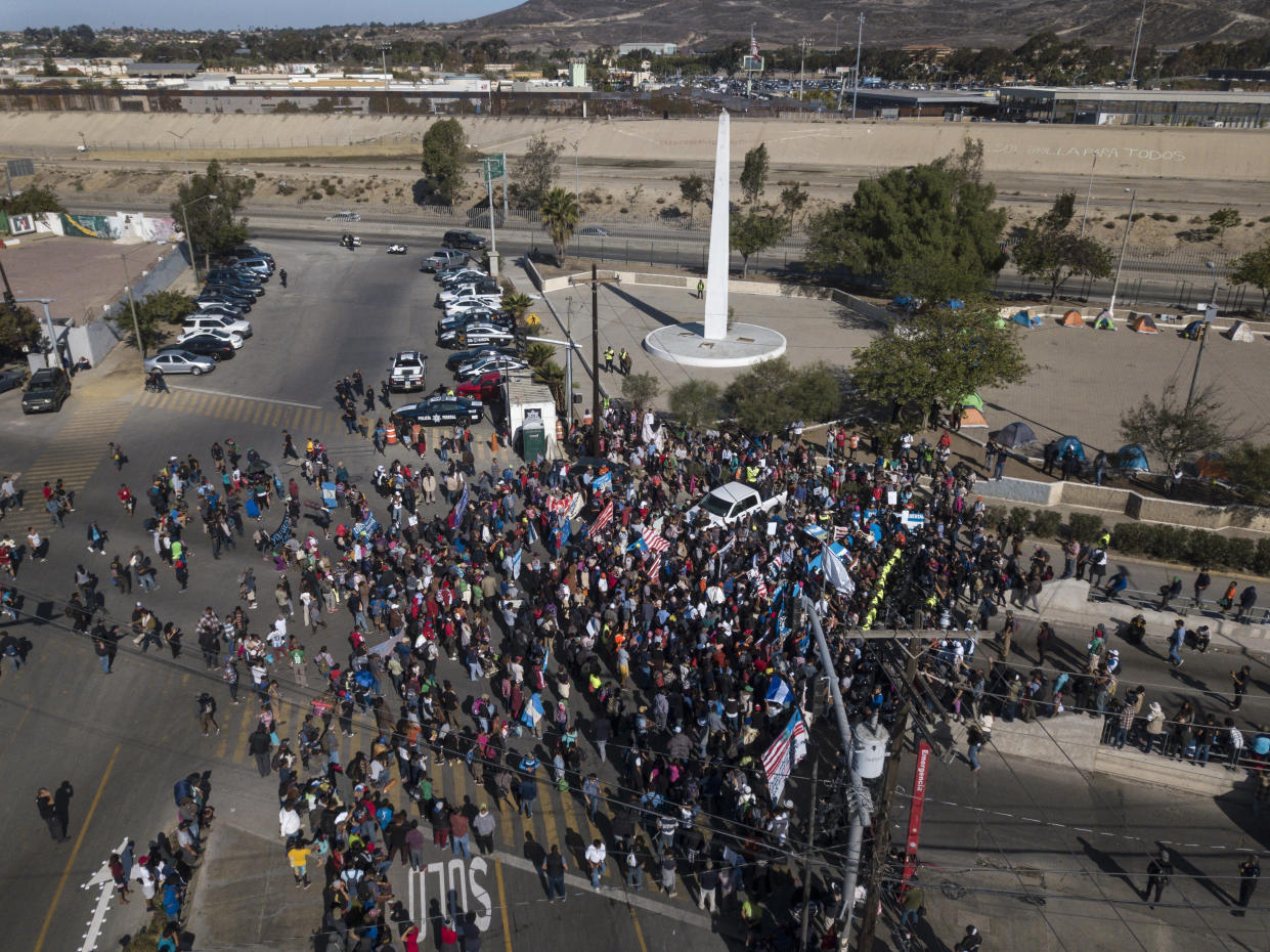 A group of migrants gather at the Chaparral border crossing in Tijuana, Mexico, Sunday, Nov. 25, 2018, as they try to pressure their way into the U.S. (Photo: Rodrigo Abd/AP)