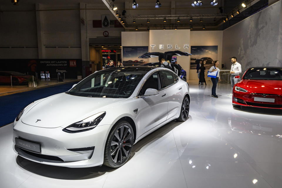 BRUSSELS, BELGIUM - JANUARY 09: Tesla Model 3 compact sedan car in white on display at Brussels Expo on January 9, 2020 in Brussels, Belgium. The Model 3 is fitted with a full self-driving system. (Photo by Sjoerd van der Wal/Getty Images)