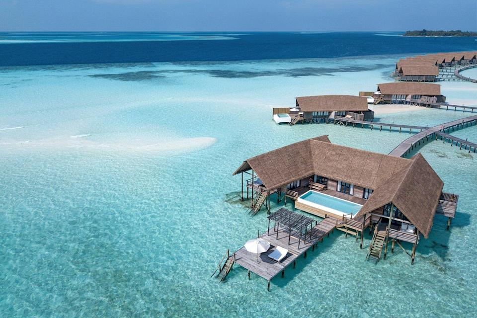 Aerial view of overwater bungalow at COMO Cocoa Island