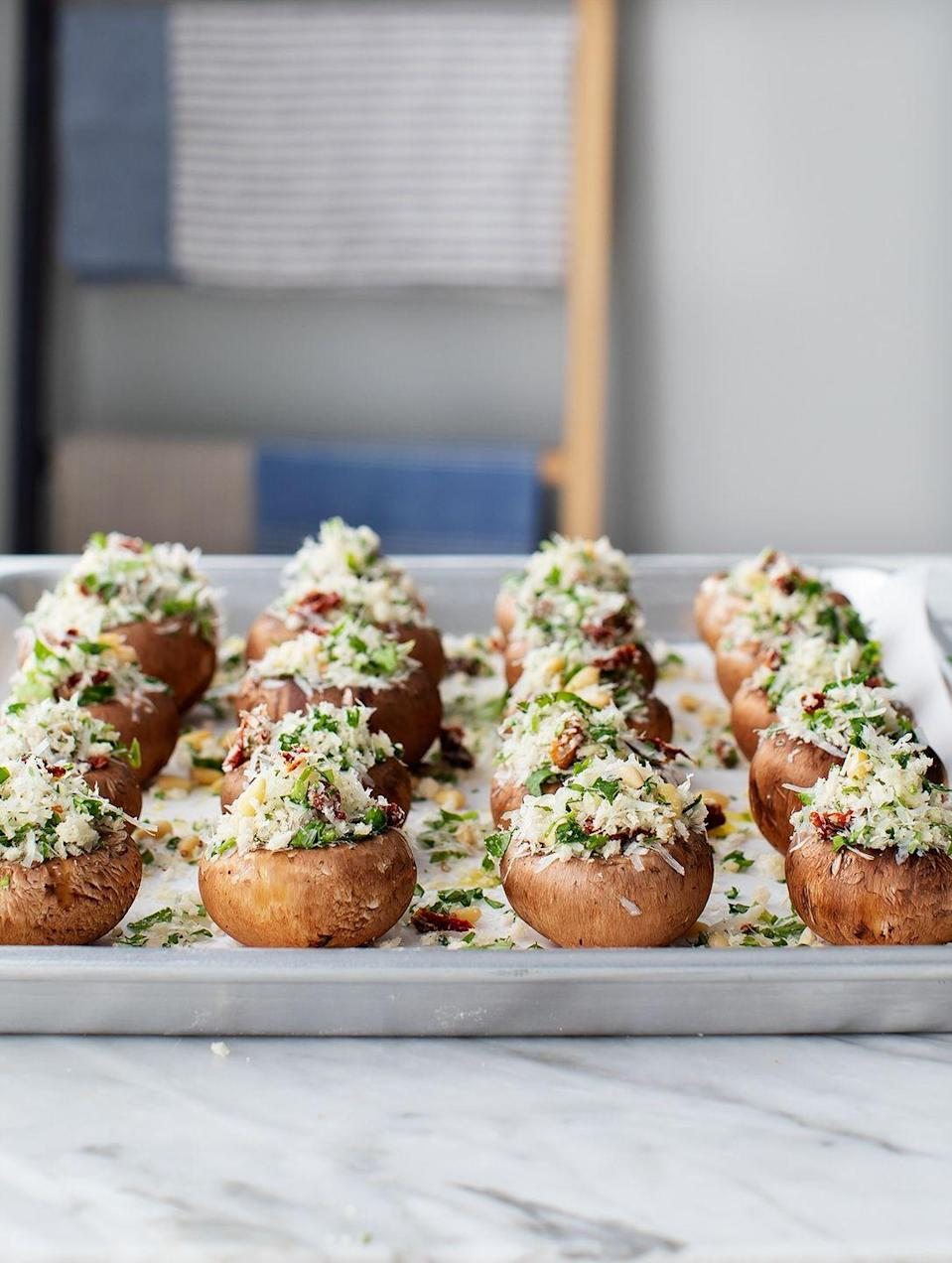 """<p>This delectable bite all but invented the concept of an hors d'oeuvre. We love how Jeanine Donofrio creates a hearty filling with canned sun-dried tomatoes; this addition will elevate your appetizer to icon status. </p><p><em><em><a href=""""https://www.loveandlemons.com/stuffed-mushrooms/"""" rel=""""nofollow noopener"""" target=""""_blank"""" data-ylk=""""slk:Get the recipe from Love and Lemons »"""" class=""""link rapid-noclick-resp"""">Get the recipe from Love and Lemons »</a></em></em> </p>"""