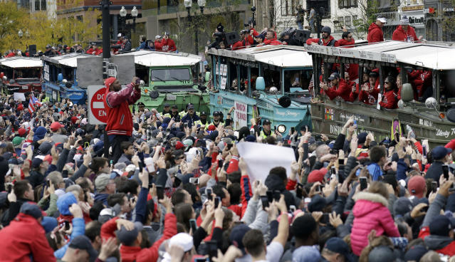 Some Red Sox fans decided to throw beer fans during the team's World Series parade. (AP Photo)