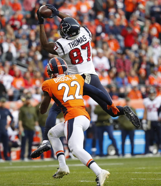 Houston Texans wide receiver Demaryius Thomas (87) makes a catch as Denver Broncos defensive back Tramaine Brock (22) defends during the first half of an NFL football game, Sunday, Nov. 4, 2018, in Denver. (AP Photo/Jack Dempsey)