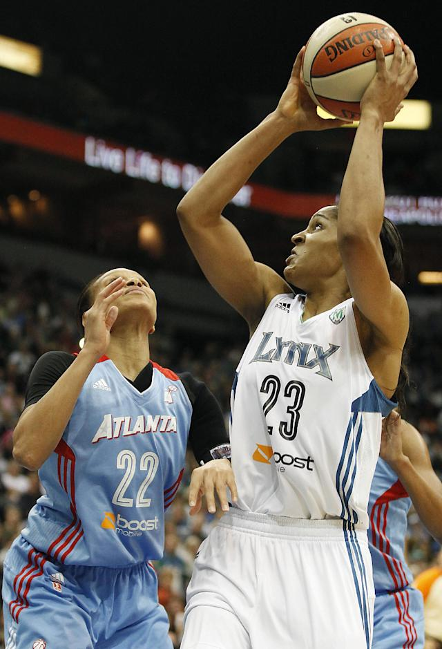 Minnesota Lynx forward Maya Moore (23) looks back to the basket against Atlanta Dream guard Armintie Herrington (22) during Game 1 of the WNBA basketball finals, Sunday, Oct. 6, 2013, in Minneapolis. The Lynx won 84-59. (AP Photo/Stacy Bengs)
