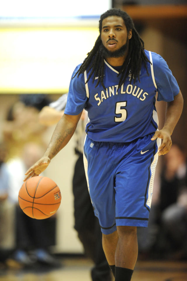 WASHINGTON, DC - MARCH 2: Jordair Jett #5 of the St. Louis Billikens dribbles up court during a college basketball game against the George Washington Colonials on March 2, 2013 at the Smith Arena in Washington, DC. The Billikens won 71-59. (Photo by Mitchell Layton/Getty Images)