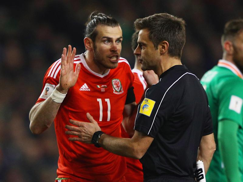 Bale insisted he was trying to slide the ball in rather than challenge John O'Shea: Getty