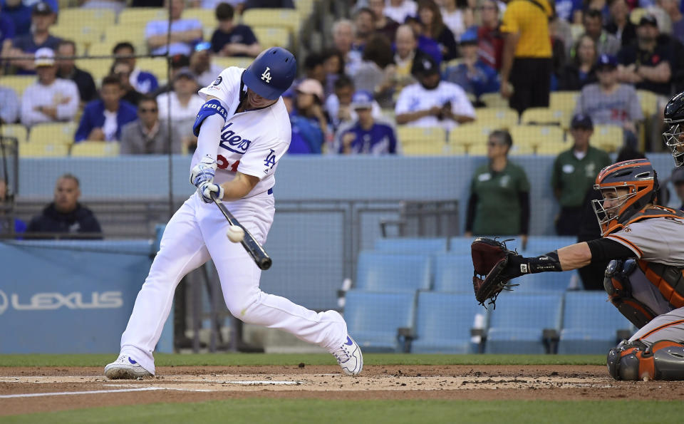 Los Angeles Dodgers' Joc Pederson hits a solo home run as San Francisco Giants catcher Buster Posey watches during the first inning of a baseball game Tuesday, June 18, 2019, in Los Angeles. (AP Photo/Mark J. Terrill)