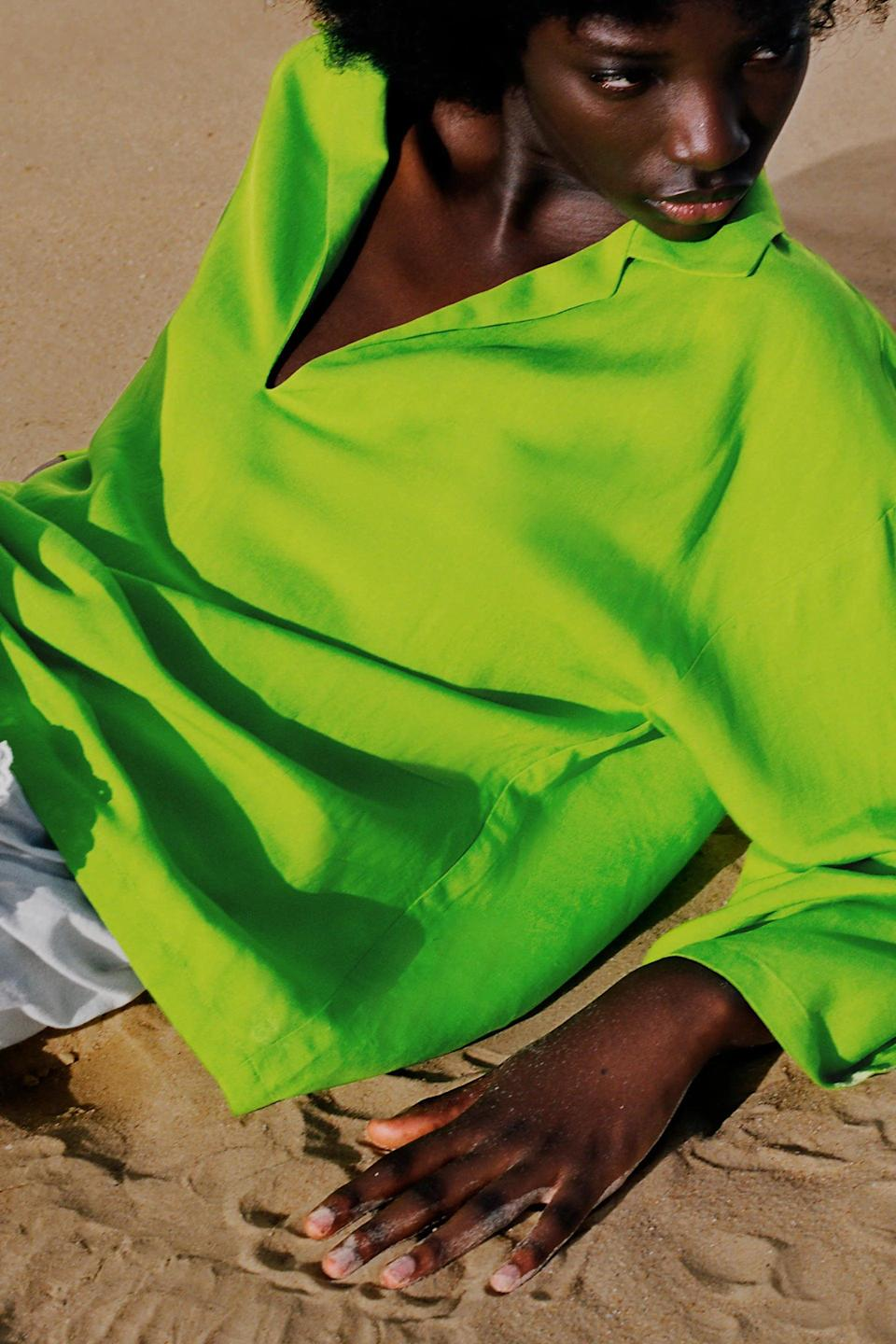 <p>If you love a little neon, then the <span>Zara Oversized Linen Blend Shirt</span> ($50) is for you.</p>