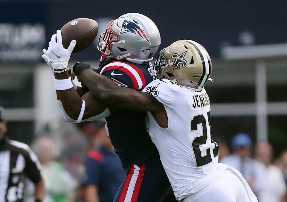 Patriots tight end Jonnu Smith, left, can't hold onto the ball as Saints defenderMalcolm Jenkins breaks up the play in the second quarter.