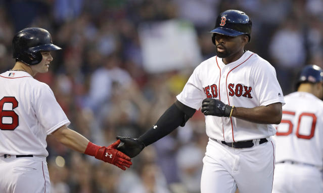 Boston Red Sox's Jackie Bradley Jr., right, is congratulated by Andrew Benintendi after his solo home run during the third inning of the team's baseball game against the Los Angeles Angels at Fenway Park in Boston, Tuesday, June 26, 2018. (AP Photo/Charles Krupa)