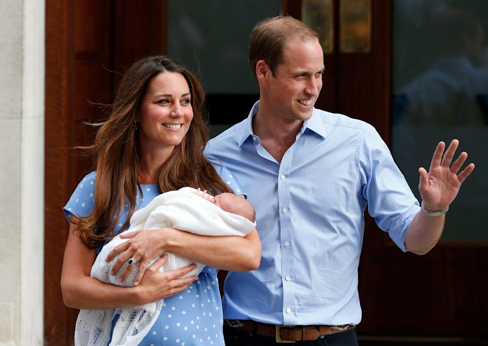Prince William and Duchess Kate of Cambridge with Prince George as they pose outside St. Mary's Hospital in London the day after he was born, July 22, 2013.