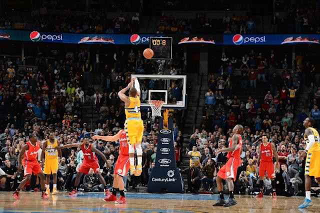 DENVER, CO - FEBRUARY 3: Randy Foye #4 of the Denver Nuggets hits the game winning shot against the Los Angeles Clippers on February 3, 2014 at the Pepsi Center in Denver, Colorado. (Photo by Garrett W. Ellwood/NBAE via Getty Images)