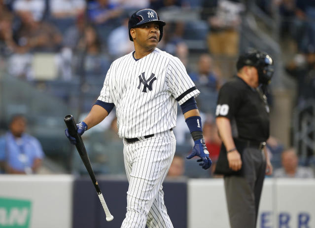 Edwin Encarnacion, the newest slugger in the Yankees lineup, strikes out in his first at-bat in pinstripes Monday night at Yankee Stadium. (USA TODAY Sports)