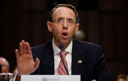 FILE PHOTO: Deputy U.S. Attorney General Rod Rosenstein testifies at a Senate Intelligence Committee hearing on the Foreign Intelligence Surveillance Act (FISA) in Washington, U.S., June 7, 2017. REUTERS/Kevin Lamarque/File Photo