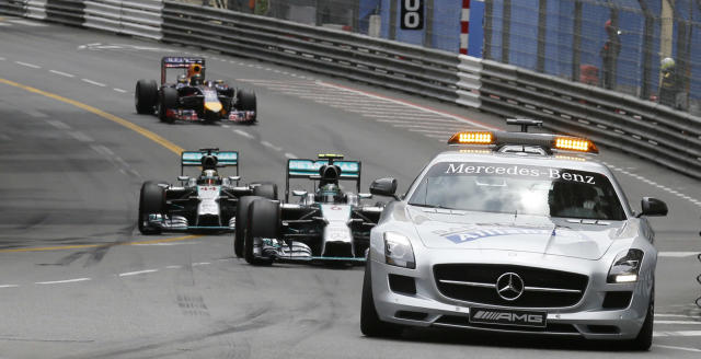 Mercedes driver Nico Rosberg of Germany, Mercedes driver Lewis Hamilton of Britain and Red Bull driver Sebastian Vettel of Germany follow a safety car during the second lap of the Monaco Formula One Grand Prix, at the Monaco racetrack, in Monaco, Sunday, May 25, 2014. (AP Photo/Luca Bruno)
