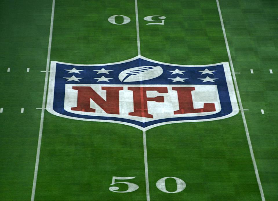 Jan 23, 2015; Glendale, AZ, USA; General view of NFL shield logo at midfield of University of Phoenix Stadium in advance of Super Bowl XLIX between the Seattle Seahawks and the New England Patriots. Mandatory Credit: Kirby Lee-USA TODAY Sports