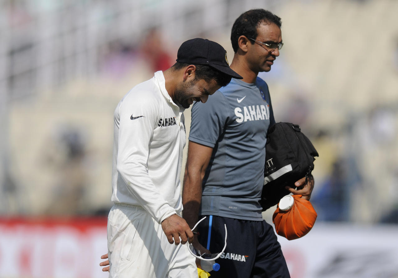 Virat Kholi of India walks back to the dressing room along with the team physio after being hit by a ball during day three of the first Star Sports test match between India and The West Indies held at The Eden Gardens Stadium in Kolkata, India on the 8th November 2013  Photo by: Pal Pillai - BCCI - SPORTZPICS