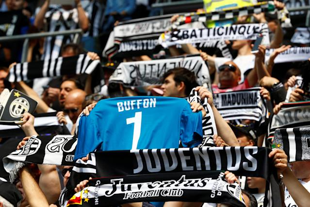Soccer Football - Serie A - Juventus vs Hellas Verona - Allianz Stadium, Turin, Italy - May 19, 2018 Juventus fan holds up a shirt in reference to Gianluigi Buffon REUTERS/Stefano Rellandini