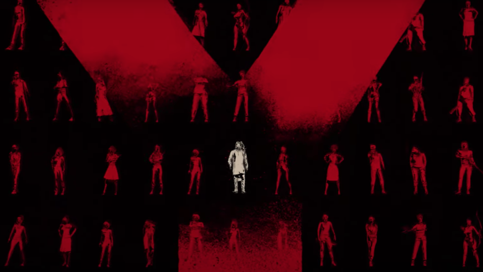 One white figure among dozens of red figures on a black background.