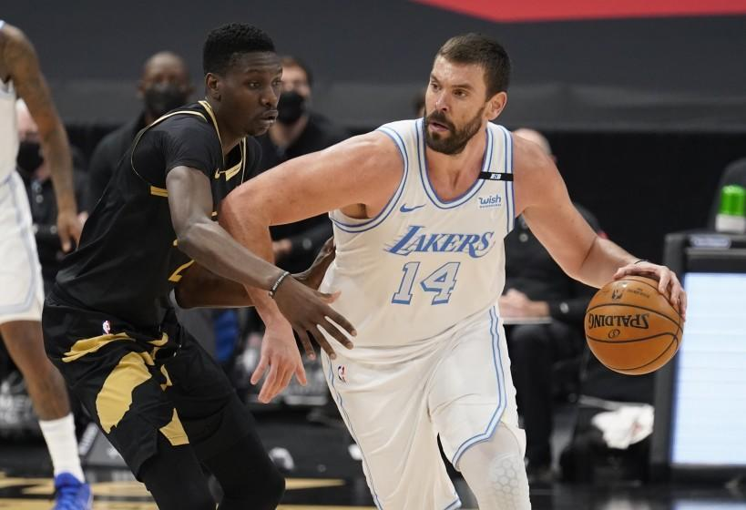 Los Angeles Lakers center Marc Gasol (14) drives at Toronto Raptors forward Chris Boucher (25) during the second half of an NBA basketball game Tuesday, April 6, 2021, in Tampa, Fla. (AP Photo/Chris O'Meara)