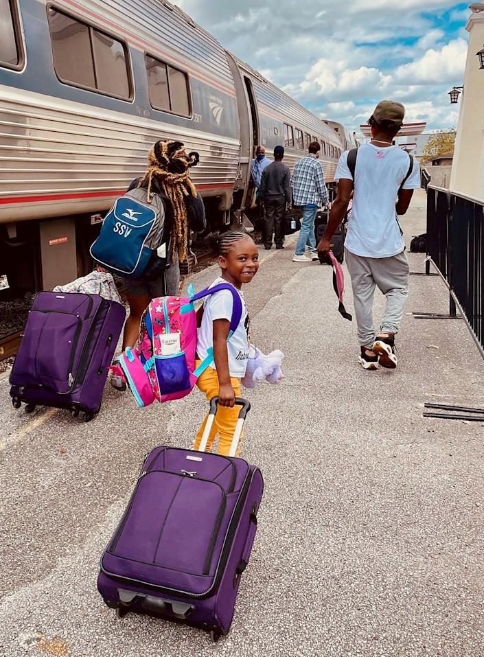 This young passenger is excited to start her Amtrak adventure.
