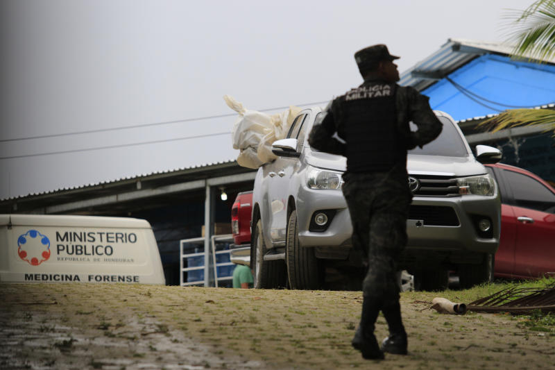 A pick-up truck loaded with the bodies of dead inmates is parked in the Tela prison where at least 18 prisoners were killed during an prisoner's riot on Friday in Tela, Honduras, Saturday, Dec. 21, 2019. The riot came several days after Honduras declared a state of emergency in its prison system. (AP Photo/Delmer Martinez)