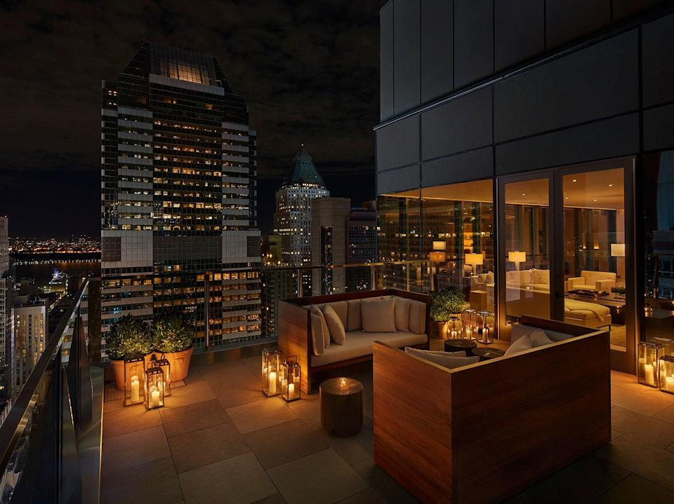"""<p>With its uncluttered, futuristic style, extensive indoor landscaping, in-house performance venue, and six dining outlets developed under the direction of a Michelin-starred chef, <a href=""""https://www.cntraveler.com/hotels/new-york/the-times-square-edition?mbid=synd_yahoo_rss"""" rel=""""nofollow noopener"""" target=""""_blank"""" data-ylk=""""slk:this 452-room hotel"""" class=""""link rapid-noclick-resp"""">this 452-room hotel</a> brought a new level of luxury to the Times Square area when it opened in 2019. Now reopening June 1 following its pandemic-related closure, the hotel will welcome guests back with lots of outdoor spaces, from the terraces of its restaurants and bars to the balconies of its 26 suites and Penthouse. The suite balconies have a couple of chairs and are framed with greenery, while the 40th-floor Penthouse's 400-square-foot terrace has been furnished with couches, chairs, and tables. While the hotel's location doesn't afford views of where <a href=""""https://www.cntraveler.com/story/new-years-eve-where-to-watch-the-ball-drop-in-new-york-city?mbid=synd_yahoo_rss"""" rel=""""nofollow noopener"""" target=""""_blank"""" data-ylk=""""slk:the ball drops on New Year's Eve"""" class=""""link rapid-noclick-resp"""">the ball drops on New Year's Eve</a>, the balconies do offer a good look at Times Square and the Hudson River. </p> <p><strong>Book now</strong>: <a href=""""https://cna.st/affiliate-link/TmDrEmPQ121kgUuYuviqSnXyWTrX49A7gRWMVrbaJ8o8SRkxvMPneTUeE8oJpv4ECZnLauZAJCiTPrqaaDGLmmmTRRkWd3cZrrS4XoKThx8F7pdTEfRdfCpaXZHJ67EYh8uPGVk?cid=5ba537046477eb358f1427b4"""" rel=""""nofollow noopener"""" target=""""_blank"""" data-ylk=""""slk:From $292 per night, marriott.com"""" class=""""link rapid-noclick-resp"""">From $292 per night, marriott.com</a></p>"""