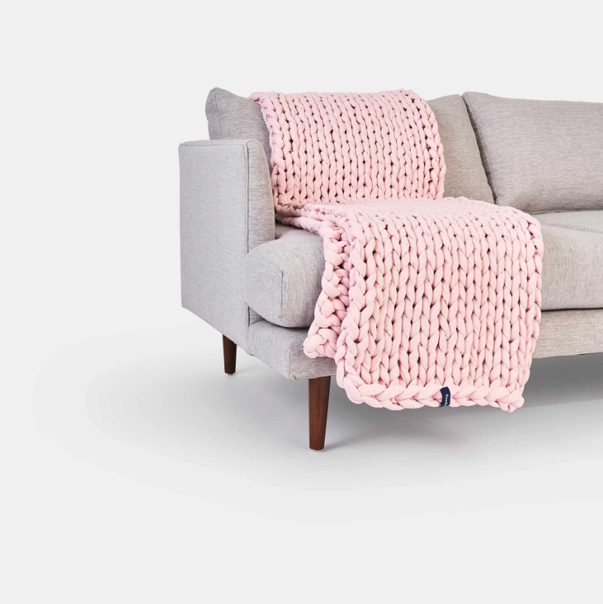 """<h3>Bearaby Classic Napper</h3><br>This beautiful napper is hand-knit with a chunky, layered weave of organic cotton and zero artificial fillers — it comes in customizable weights of 15, 20, or 25 lbs. <br><br><strong>The hype:</strong> 5 out of 5 stars and 912 reviews on <a href=""""https://bearaby.com/products/the-napper"""" rel=""""nofollow noopener"""" target=""""_blank"""" data-ylk=""""slk:Bearaby"""" class=""""link rapid-noclick-resp"""">Bearaby</a><br><br><strong>What they're saying:</strong> """"Perfect for cooler sleeping! I really like weighted blankets but get very easily hot under them. This knitted style has worked perfectly at night, with a flat sheet under it. I am sleeping much more soundly now, compared to a light blanket."""" <em>– Melissa, Bearaby reviewer</em><br><br><strong>Bearaby</strong> The Napper, $, available at <a href=""""https://go.skimresources.com/?id=30283X879131&url=https%3A%2F%2Fbearaby.com%2Fproducts%2Fthe-napper"""" rel=""""nofollow noopener"""" target=""""_blank"""" data-ylk=""""slk:Bearaby"""" class=""""link rapid-noclick-resp"""">Bearaby</a>"""