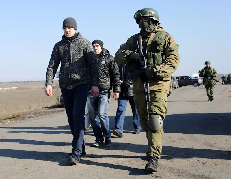 Pro-Russian rebels carry out a Ukrainian prisoner exchange near Marinka, Donetsk region