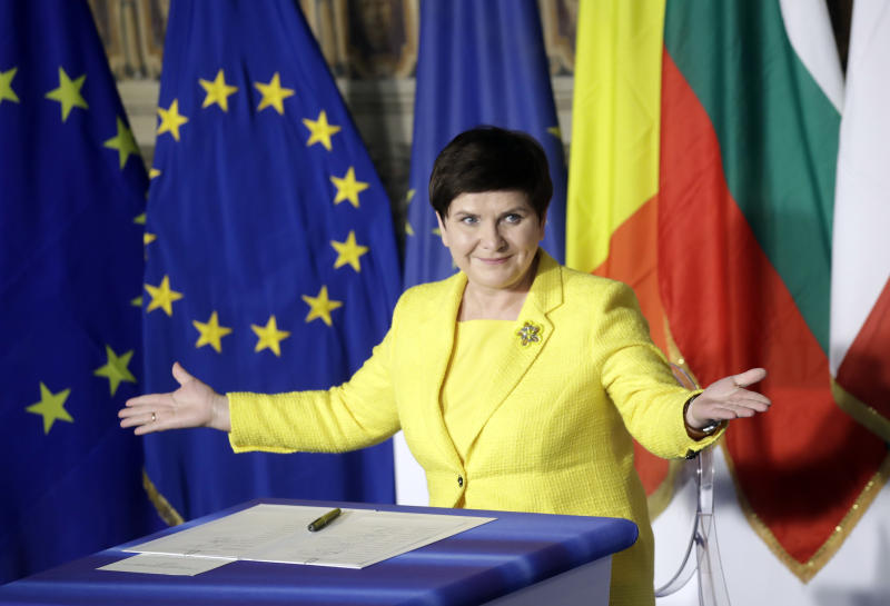 Polish Prime Minister Beata Szydto gestures after signing a declaration during an EU summit meeting at the Orazi and Curiazi Hall in the Palazzo dei Conservatori in Rome on Saturday, March 25, 2017. European Union leaders were gathering in Rome to mark the 60th anniversary of their founding treaty and chart a way ahead following the decision of Britain to leave the 28-nation bloc. (AP Photo/Alessandra Tarantino)