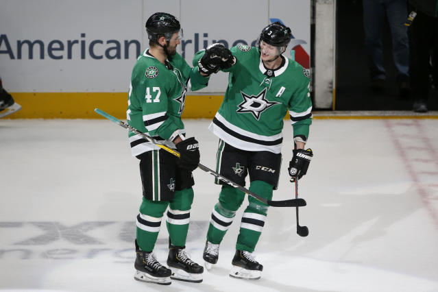Dallas Stars right wing Alexander Radulov (47) is congratulated by defenseman John Klingberg (3) after Radulov scored the winning goal against the Colorado Avalanche during a shootout of an NHL hockey game in Dallas, Saturday, Dec. 28, 2019. The Stars defeated the Avalanche 3-2. (AP Photo/Michael Ainsworth)