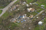 In this aerial photo, the remains of destroyed homes are seen in the aftermath of Hurricane Ida, Monday, Sept. 6, 2021, in Lafitte, La. (AP Photo/Matt Slocum)