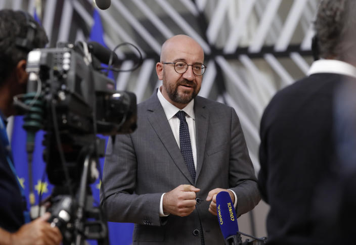 """FILE - In this May 24, 2021 file photo, European Council President Charles Michel speaks with the media as he arrives for an EU summit at the European Council building in Brussels. Joe Biden's first foreign trip as U.S. president takes in a Group of Seven meeting by the seaside in southwest England, a NATO summit and a meeting with European Union chiefs in Brussels and a tete-a-tete in Geneva with his Russian counterpart and adversary, Vladimir Putin. """"America is back. And we are happy you are back,"""" Michel told Biden in March, when the president joined a videoconference summit of EU leaders. (Olivier Hoslet/Pool Photo via AP, File)"""