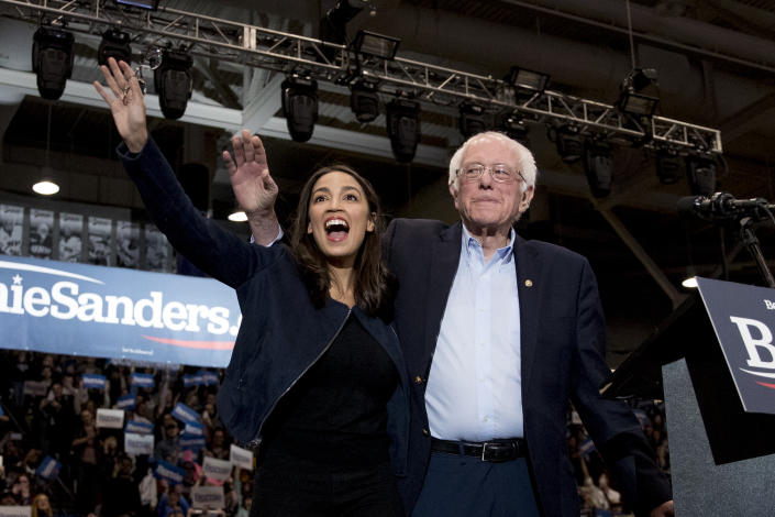 Sen. Bernie Sanders, I-Vt., accompanied by Rep. Alexandria Ocasio-Cortez, D-N.Y., left, takes the stage at campaign stop at the Whittemore Center Arena at the University of New Hampshire, Monday, Feb. 10, 2020, in Durham, N.H. (Andrew Harnik/AP)