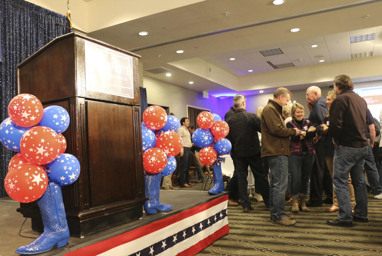 The stage is prepared for the arrival of Republican congressional candidate Greg Gianforte, who was seeking to become Montana's sole member in the U.S. House, at a hotel in Bozeman, Mont., Thursday, May 25, 2017. Gianforte won Montana's only U.S. House seat on Thursday despite being charged a day earlier with assault after witnesses said he grabbed a reporter by the neck and threw him to the ground. (AP Photo/Bobby Caina Calvan).