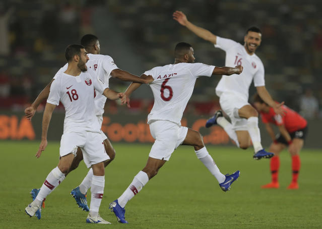 Qatar's midfielder Abdelaziz Hatem, center, celebrates his opening goal with his teammates, during the AFC Asian Cup quarterfinal soccer match between Korea Republic and Qatar at the Zayed Sport City Stadium in Abu Dhabi, United Arab Emirates, Friday, Jan. 25, 2019. (AP Photo/Kamran Jebreili)