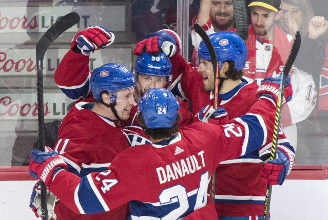 Montreal Canadiens' Tomas Tatar (90) celebrates with teammates Brendan Gallagher (11), Phillip Danault (24) and Ben Chiarot after scoring during first period NHL hockey action against the St. Louis Blues, in Montreal, Saturday, Oct. 12, 2019. (Graham Hughes/The Canadian Press via AP)
