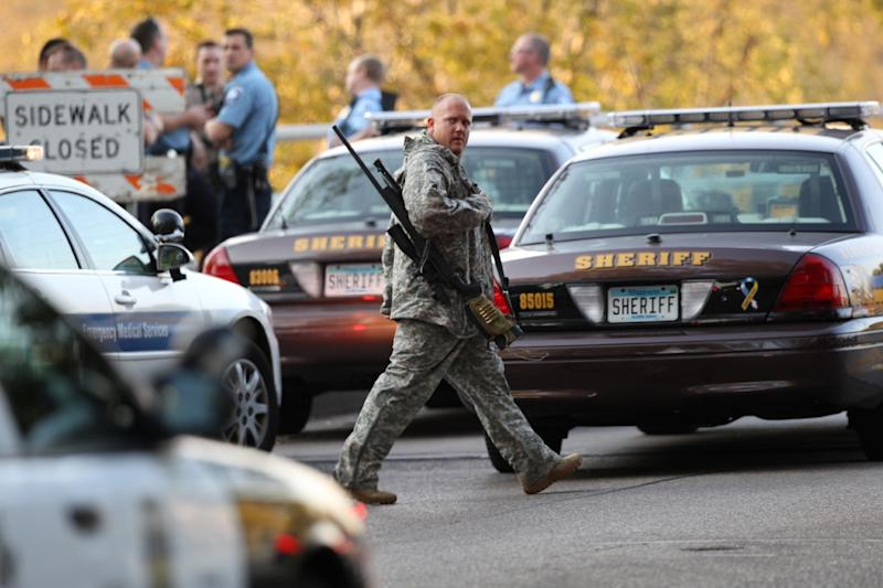 An officer walks through the area as police investigate a shooting at Accent Signage Systems on the north side of Minneapolis Thursday, Sept. 27, 2012. Police say left at least two people were killed and four others wounded. (AP Photo/The Star Tribune, Renee Jones Schneider) MANDATORY CREDIT; ST. PAUL PIONEER PRESS OUT; MAGS OUT; TWIN CITIES TV OUT